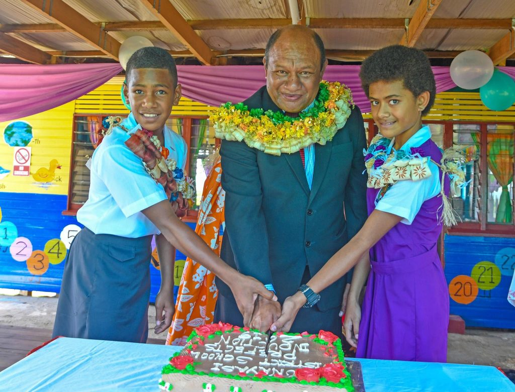 Minister for Forests, Hon. Osea Naiqamu cuts cake with student prefects of Vunayasi Primary School to mark the launch of activities leading up to International Day of Forests 2019.